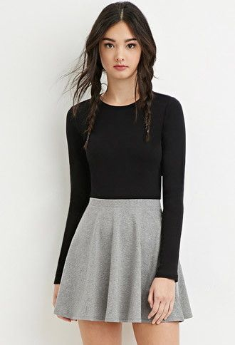 black top, grey skater skirt.