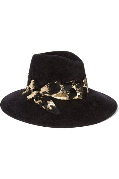 Black rabbit-felt, black and gold feathers 100% rabbit-felt; trim: 100% feathers (Turkey) Spot clean