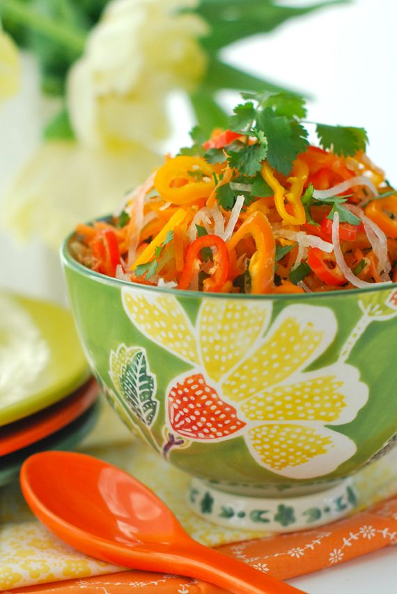 Carrot, Jicama & Sweet Pepper Slaw  Yield: approx 5 cups  6 carrots, peeled & shredded  1 small jicama, peeled & shredded  12 mini sweet peppers thinly sliced, or reg. sweet peppers  1 cup cilantro, chopped or snipped  juice of one lime, approx 3 tbsp  1/4 cup extra virgin olive oil  2 tbsp agave syrup  1 large clove garlic, crushed  1/2 tsp cumin  1/4 tsp cayenne or to taste  1/8 tsp sea salt