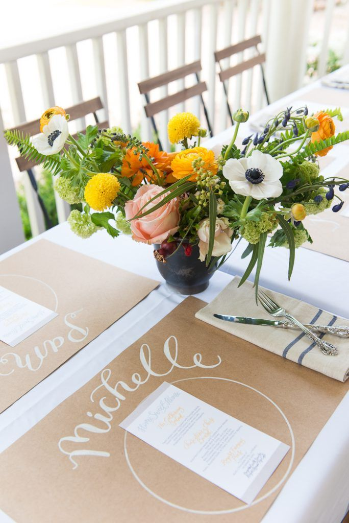 Pretty centerpiece with handwritten placemats including menu.What is it about white ink on kraft paper that we love so?