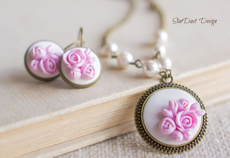polymer clay roses, polymer clay jewelry https://www.facebook.com/stardustbyoanaconstantin?ref=hl