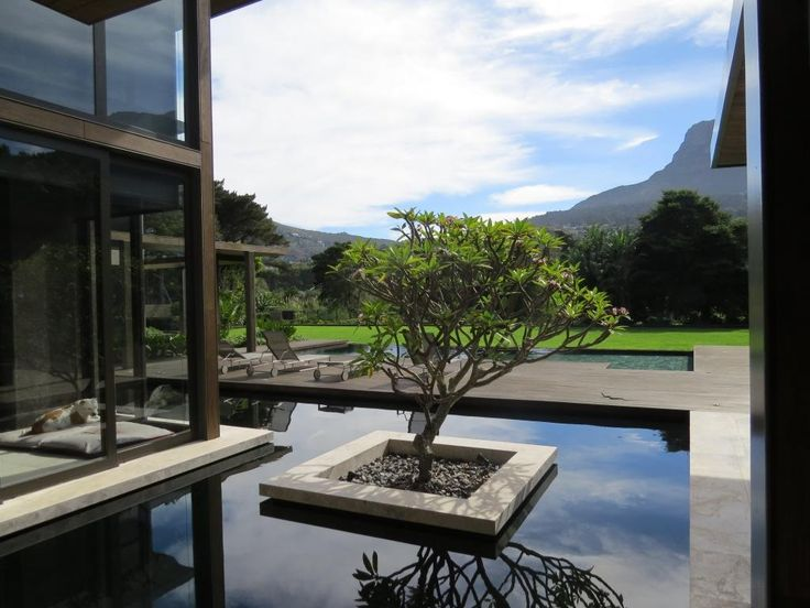 Koi pond. Thai Contemporary fusion home, Cape Town, South Africa. By RennieScurrAdendorff Architects