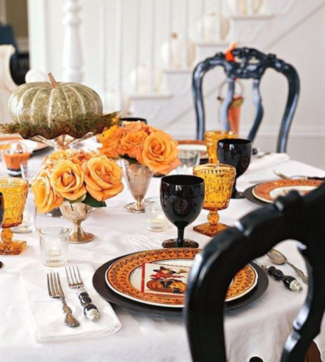 Romantic Halloween table setting with orange roses and dark goblets make any autumn get-together a little more special!