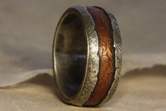 A ragged, rustic mans ring made of sterling silver and copper. Perfect as a simple engagement ring or wedding ring. This ring is 10mm wide but works well at lesser widths. Artists statement: As with all my work i strive to create an object which is both unique and timeless. Not of any