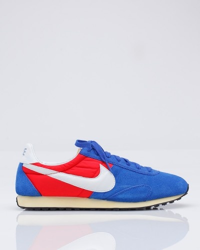 """Nike Pre Montreal Racer In Blue    Nike    Vintage racer from Nike, modeled after 1970's running shoes. Mesh and textile upper, with EVA midsole for lightweight cushioning and waffle pattern at outsole for traction and durability. Lightweight with an old-school profile, this shoe pays tribute to the glory days of running and one of the legends of the sport, Steve Prefontaine.    .75"""" heel    Color    Size    $85.00"""