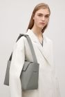 COS image 6 of Rubberised leather tote bag in Dark Sage