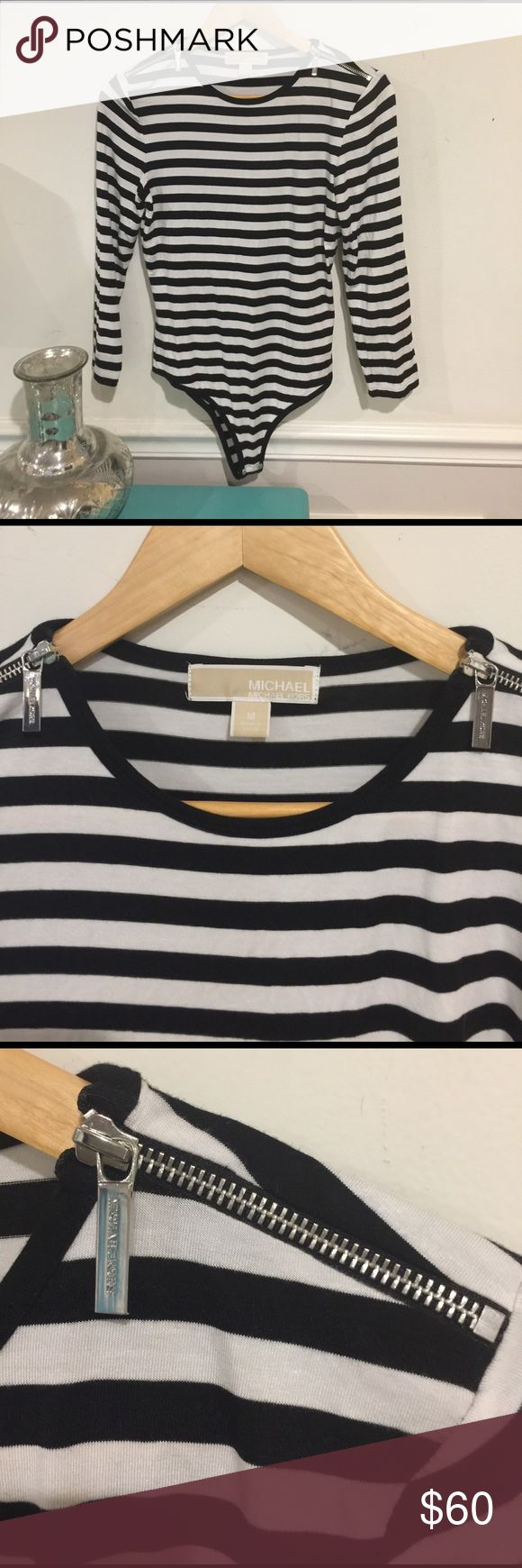 MICHAEL KORS EUC Striped bodysuit. Black and white EUC. Wore one time. Black and white stripes with snap crotch. Super soft and stretchy. Looks awesome tucked into a high waisted bottom. Silver zipper detail and neckline. Size medium Michael Kors Tops Tees - Long Sleeve