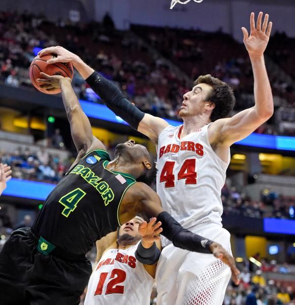 Baylor guard Gary Franklin (4) has a shot stopped by Wisconsin forward Frank Kaminsky (44) during an NCAA men's college basketball tournament regional semifinal, Thursday, in Anaheim, Calif. (Mark J. Terrill/AP)