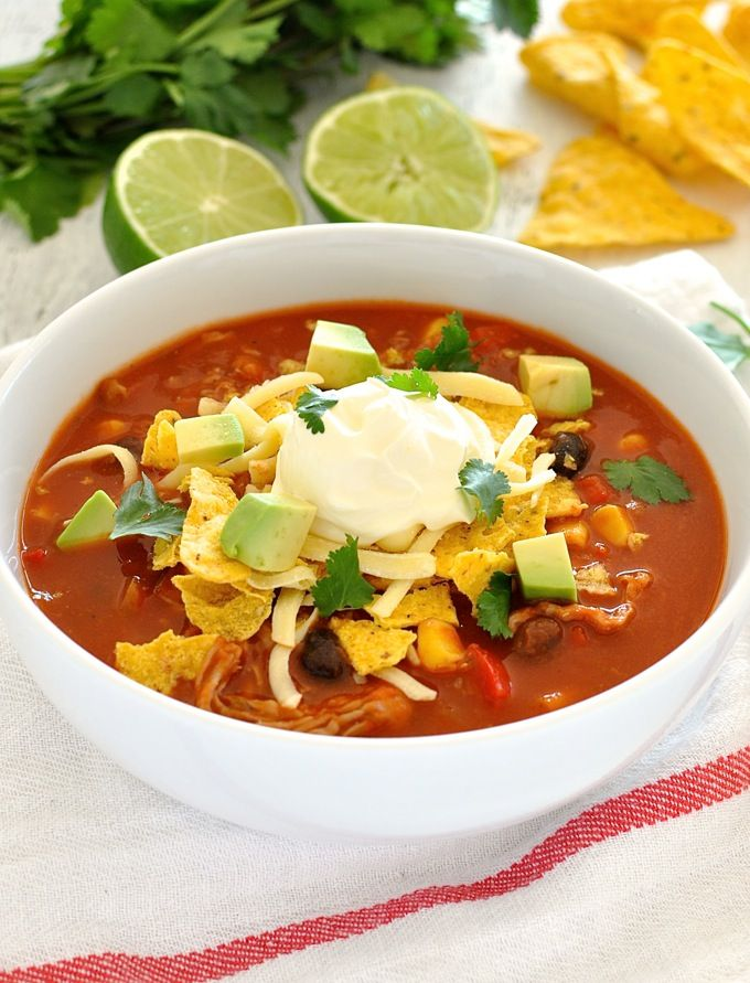 Enchilada soup on the table in 15 minutes. Toppings are not optional, so swap your sour cream for Greek Yogurt to lighten it up a bit!