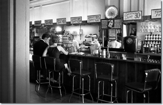 At the lunch counter in the Jefferson Hotel with his date for the day........(Wertheimer)