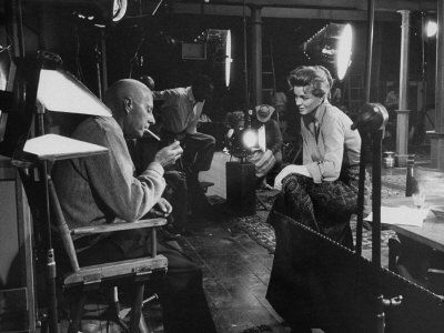 "#Cinema Howard Hawks on the set of ""Rio Bravo"" with Angie Dickinson. Howard Hawks was born in Goshen, Indiana on May 30, 1896."
