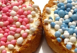 Beschuit met muisjes, when a baby is born, this is what we treat; rusk with anise hail in blue or pink.