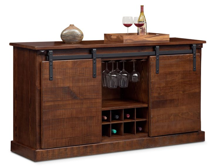 Uncork and Unwind. Display your wine in style with the rustic Ashcroft media credenza with wine storage. Featuring unique, sliding barn-door hardware and a distressed chocolate finish, this credenza includes a stemware rack, space for eight bottles of wine and storage for electronics or other collectibles. Ample space on top can be used to place your TV on or be used as a bar during gatherings with friends.