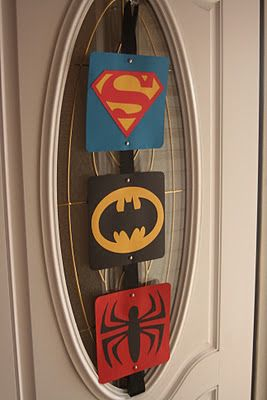 It is simply all paper and ribbon. The squares are 8 1/2 x 8 1/2 and the symbols were cut out on the Cricut using my SCAL software. She took this home to hang in the boys' room.