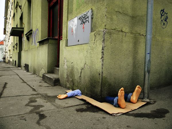 """This funny piece of street art in Prague shows a man who either chose the wrong place to take a nap or suffered a terrible teleporation accident. The artist, Fra.Biancoshock, describes himself as """"just a person who wants to communicate with us, so he decided to do so in the least conventional way possible."""""""
