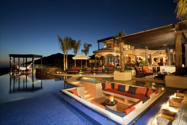 This is an amazing residence... love the pool and seating area wrapped by the pool.