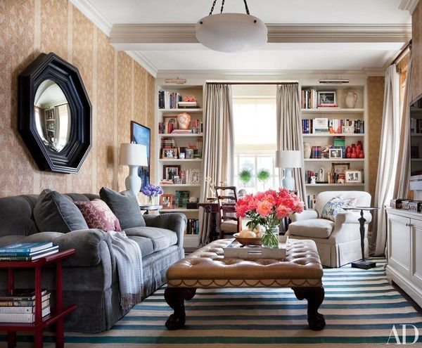 In Ali Wentworth and George Stephanopoulos's Manhattan apartment, which was designed by Michael S. Smith, the library's mirror and ottoman are by English Georgian; the sofa and armchair are by O. Henry House.