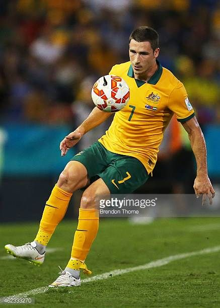 Mathew Leckie of Australia controls the ball during the Asian Cup Semi Final match between the Australian Socceroos and the United Arab Emirates at...