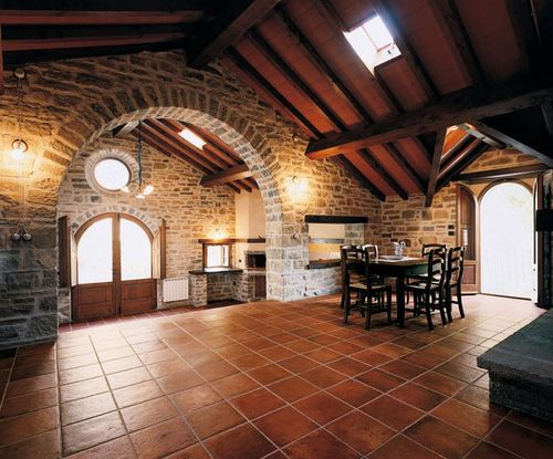 A beautiful natural, earthy floor. #terracota #tiles #brick #arch