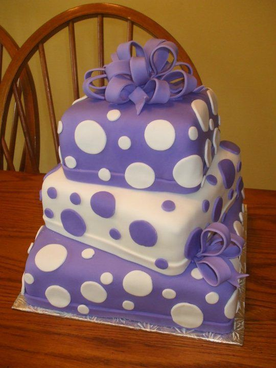 I would have one layer as polka dots, another layer in stripes and the last layer in swirls or ruffles.