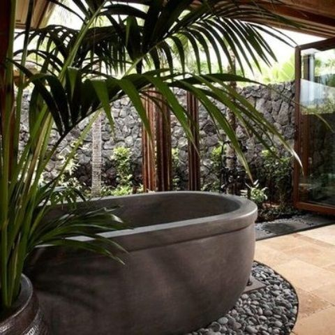 42 Inspiring Tropical Bathroom Décor Ideas : 42 Amazing Tropical Bathroom Décor Ideas With Black Bathtub Stone Ornament And Hardwood Floor And Plant Decor And Big Window Glass Door And Ceramic Floor And Outdoor View