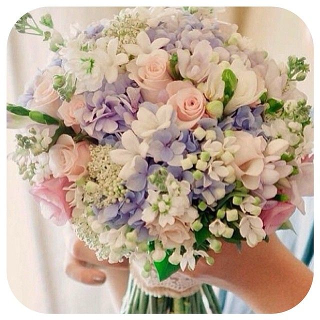 This is it. This is the bouquet. Except blue hydrangeas instead of purple. I am totally going to recreate this.