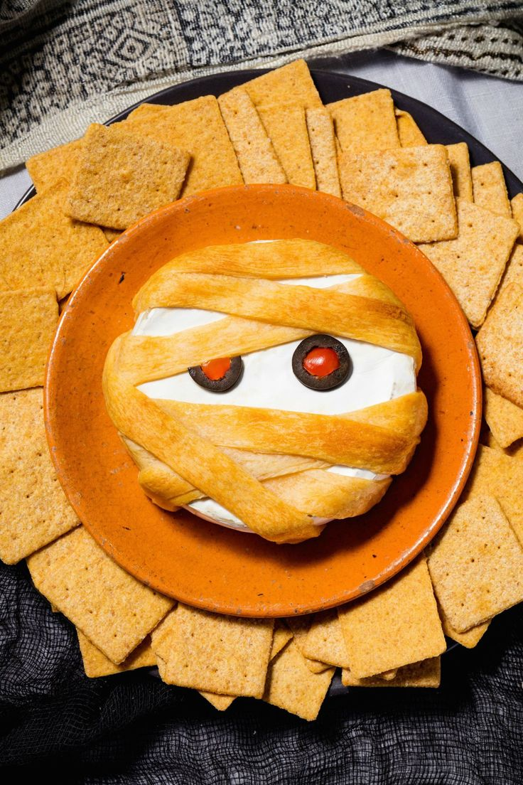 Mummy Brie Thanks to puff pastry, your basic baked brie becomes a totally spooky Halloween appetizer. Get the recipe from Delish. Ethan Calabrese