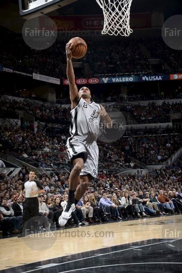 SAN ANTONIO, TX - DECEMBER 28: Patty Mills #8 of the San Antonio Spurs shoots…
