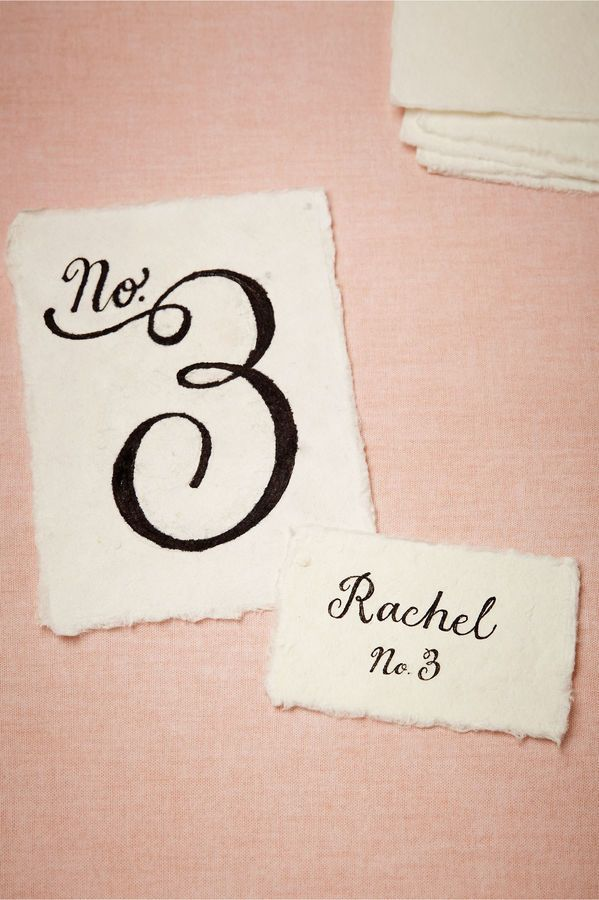 Escort cards and table numbers on hand-torn cotton paper