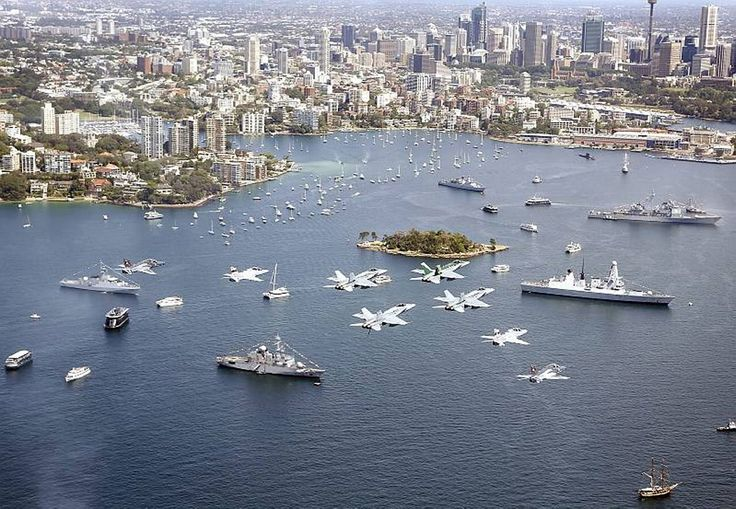 RAAF Hawk-127 aircraft from 76 Squadron and F/A-18 Hornets from 77 Squadron conduct a flypast over Sydney Harbour in formation for the International Fleet Review.