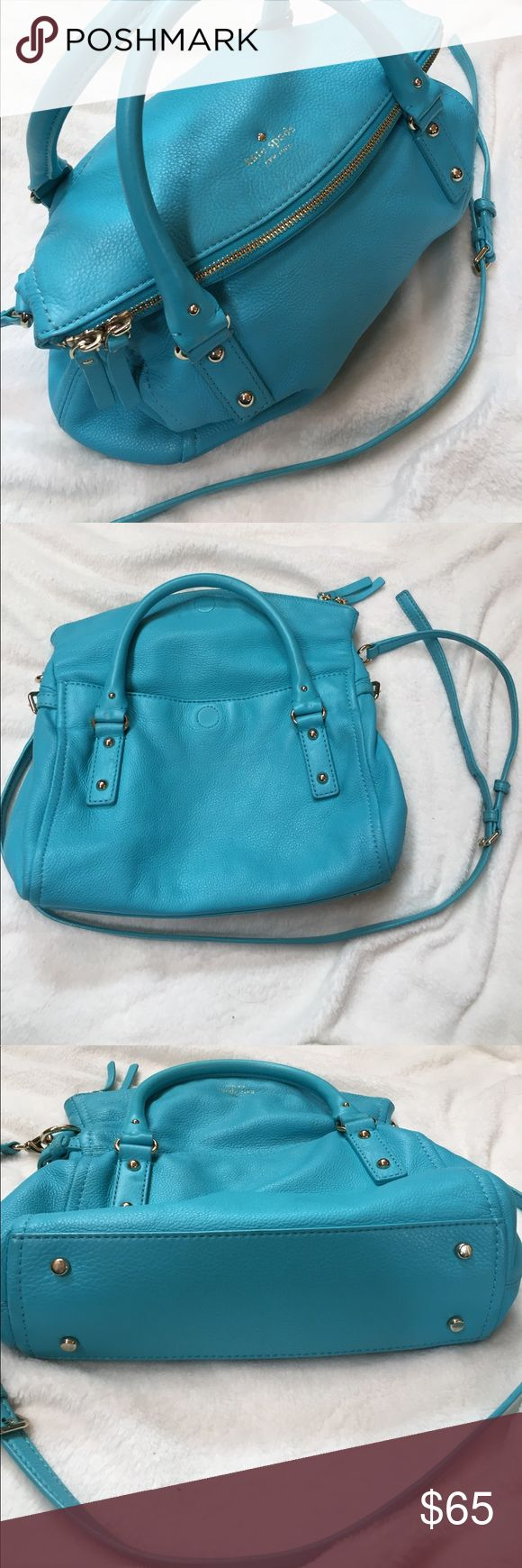 Kate Spade teal purse Kate Spade ♠️ leather cross body or hand purse. Beautiful color, with a zippered main compartment that folds over and closes magnetically to cover another open pocket. Some signs of wear in the hand and cross body straps. Body of the bourse is in excellent condition. Inside has some blue stains. All flaws shown in pictures. I bought this purse used and it smelled of cigarette smoke, which I removed from the outside leather, but the inside still slightly smells, but…