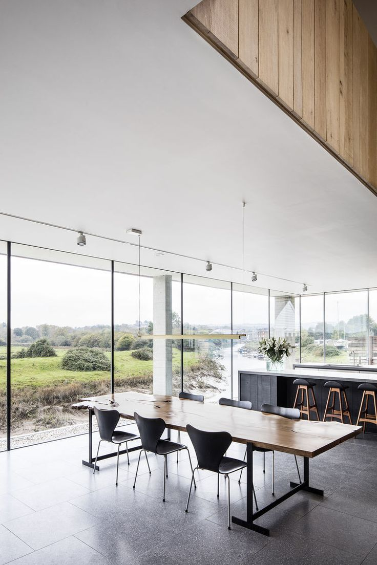 Open Plan Dining Room With Floor To Ceiling Glass