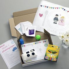 A box of treats, crayons, colouring pages, bubbles etc... to keep the kids busy at the table.