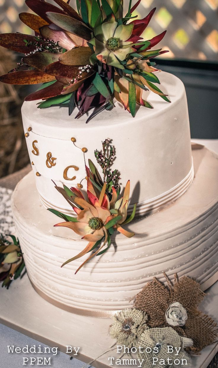 Stunning Monogram and Burlap triple chocolate ganache fondant covered cake. Topped with native flowers and decorated with burlap flowers made by Perfectly Planned Event Management. Cake designed by https://www.facebook.com/StylingElegance?fref=ts