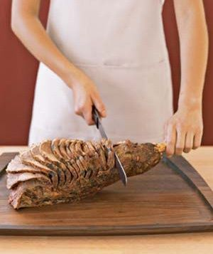 How to carve a bone in leg of lamb!  Show off your knife skills in 4 simple steps.