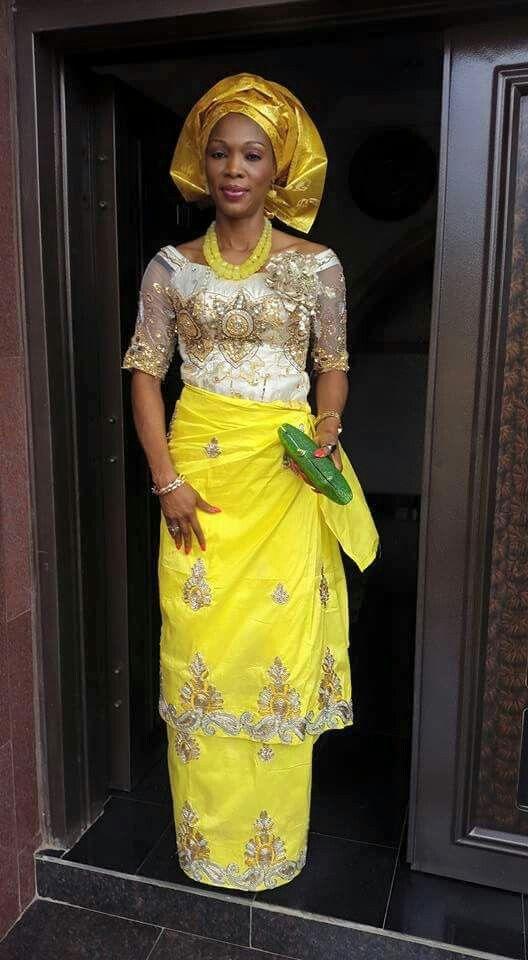 Wedding. Igbo woman. Yellow george material. Nigerian wrapper. My sister Ijeoma