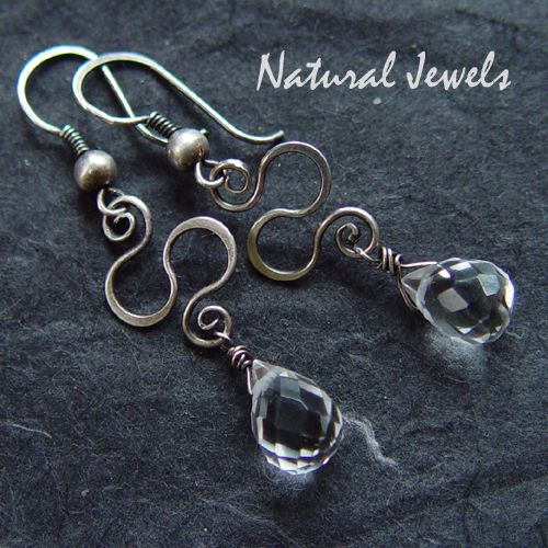 Earrings made of 925 Sterling silver and a briolet of Rock-crystal, hanging on a beautiful ornament of silver.