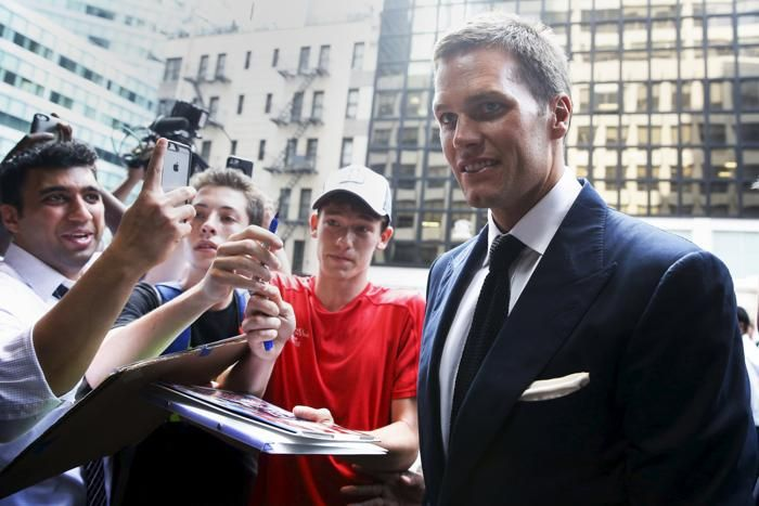 New England Patriot's quarterback Tom Brady arrives at NFL headquarters as people ask for autographs in New York June 23, 2015. Tom Brady's appeal of his four-game National Football League suspension for participating in a scheme to deflate footballs during last season's playoffs begins Tuesday at NFL headquarters in New York. REUTERS/Shannon Stapleton