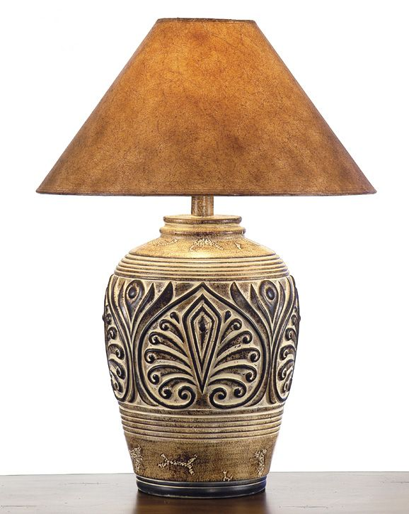 ~ Beautiful southwestern lamp. Love the shade and esp. the intricate detailing in the base. Rustic and works for me. ~
