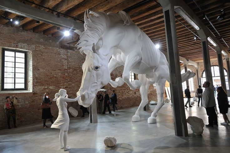 A Girl Encounters a Giant White Horse Frozen in Mid-Air Within the Venice Biennale's Argentinian Pavilion   Colossal