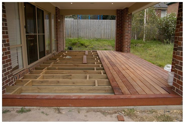 innovative wood deck and concrete patio yard