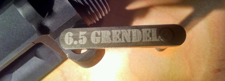 6.5 Grendel engraved on an AR magazine catch release. For more information go to arieslaser.com
