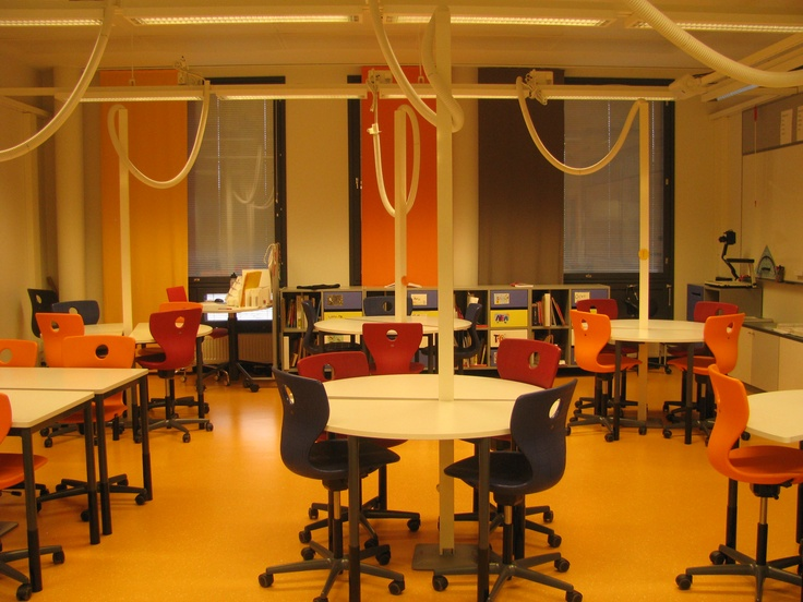 Ritaharju School, Oulu - a computer room with attractive colour scheme mainly in the furniture and flexible pipes carrying the wires become a design feature.