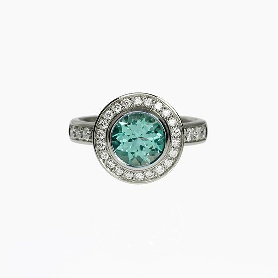 This gorgeous Halo engagement ring has 2.52ct (8.50mm diameter) Light green tourmaline in bezel setting and gorgeous Diamonds on the halo