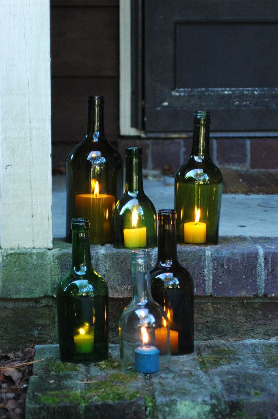 Recycled wine bottles as outdoor luminarias #gardenchat #repurpose for holiday lighting.