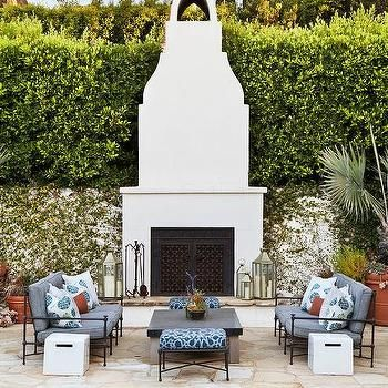 Mediterranean Backyard with White Stucco Moorish Style Outdoor Fireplace