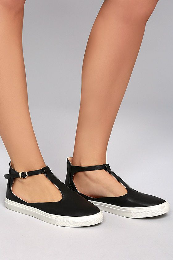 "The Gemma Black T-Strap Sneakers bring the chic to street style! Supple vegan leather shapes a rounded toe and T-strap upper, with adjustable shiny gold buckle ankle strap. 1"" white bumper sole."