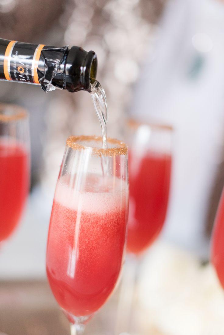 Pomegranate Blood Orange Prosecco Sparkler - prosecco, sugar rims and bright San Pellegrino make this drink a simple stunner