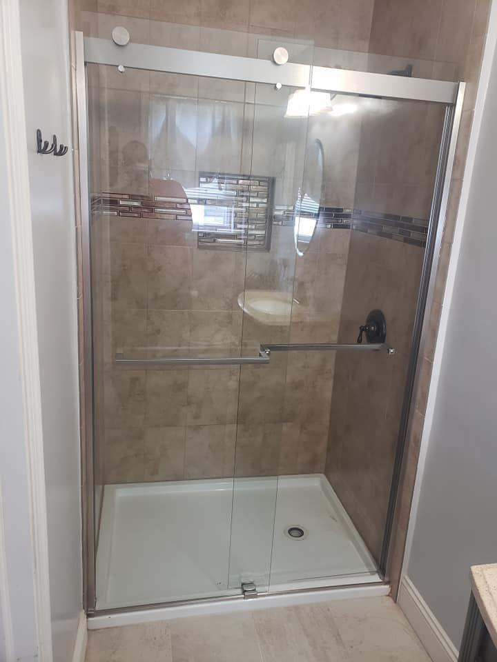 Dreamline S Sapphire Semi Frameless Bypass Shower Door In This Modern Bathroom Renovatio In 2020 Modern Bathroom Renovations Frameless Bypass Shower Doors Shower Doors