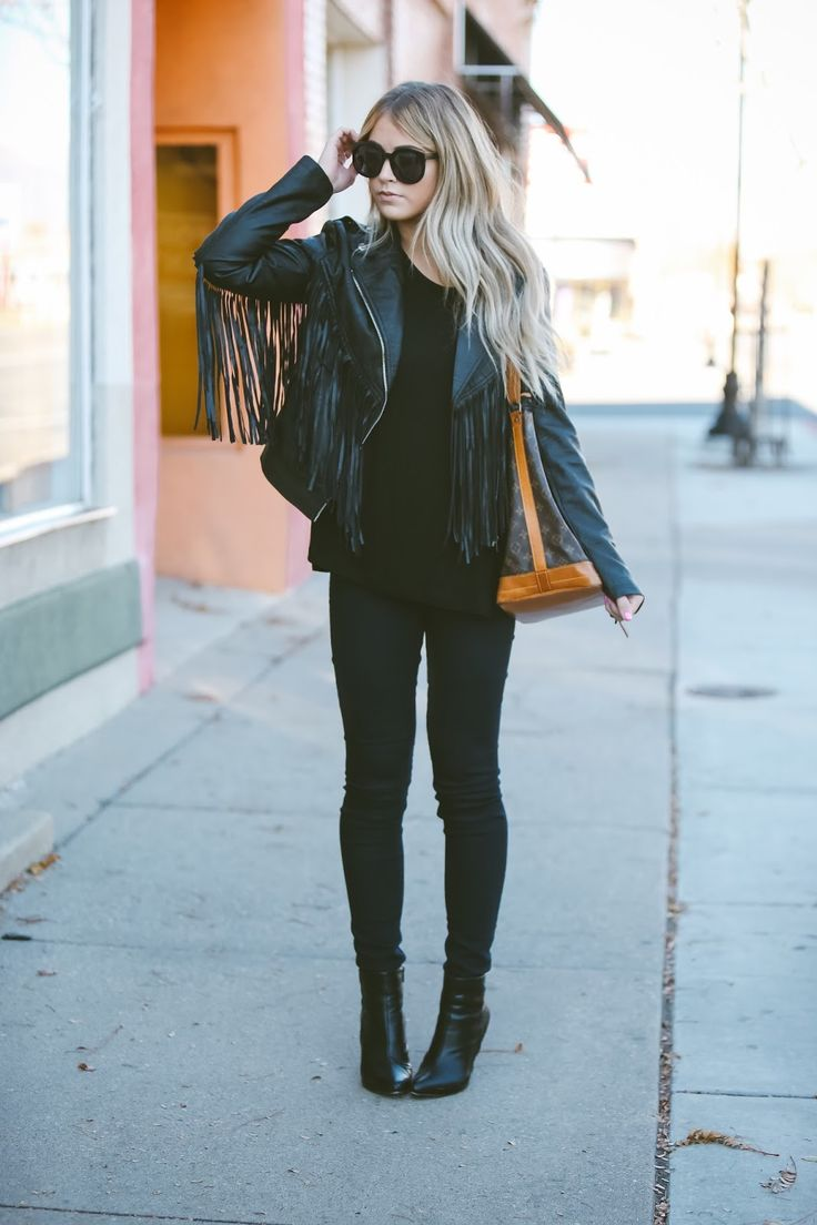 Fringed leather jackets are always a winner! Cara Loren wears this gorgeous jacket with an all black outfit consisting of a plain tee, skinny jeans, and ankle boots; a simplistic but sophisticated look. Jacket/Top: Cara Loren Shop.
